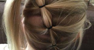 Haarschnittmädchen halbe lange Zöpfe